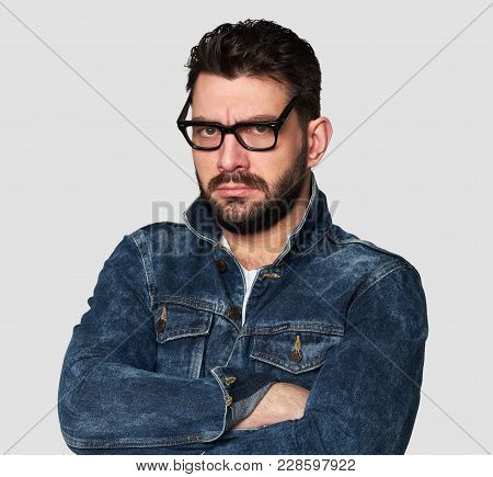 Serious Stylish Young Bearded Man In Spectacles