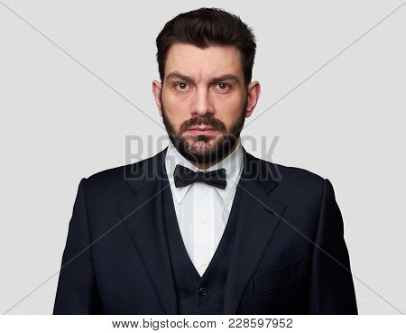 Confident Handsome Bearded Man In Classic Suit