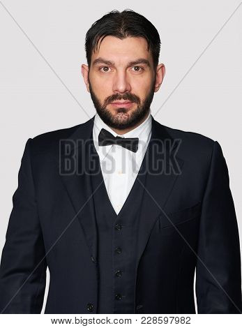 Bearded Man Wearing Classic Suit And Bow Tie
