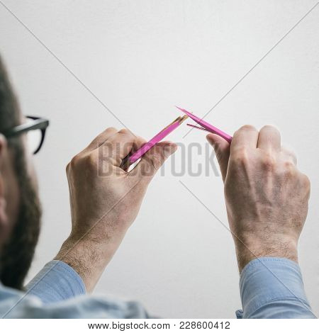 Disappointed And Angry Man Breaks A Pencil From Tension. Concept Of Anger, Frustration, Failure.
