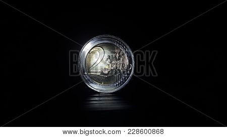 Two Euros Coin On A Black Background