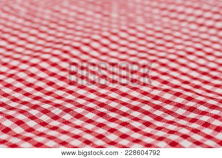 Checkered Tablecloth Kitchen Selective Focus. The White And Red Checkered Background. Selective Focu