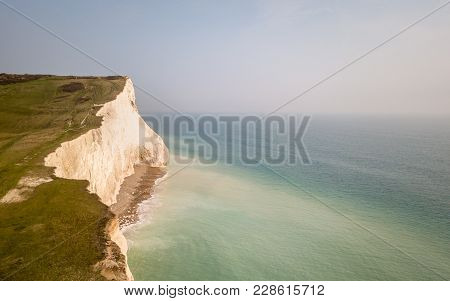 White Chalk Cliffs Of Seven Sisters, Sussex, England. Aerial Drone View Of The Coastline On The Sout