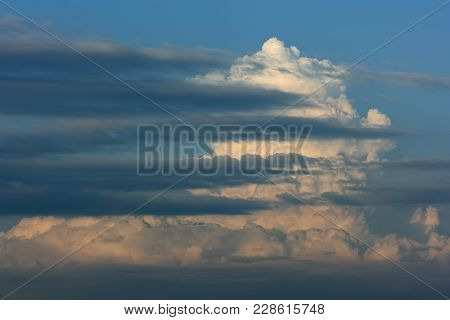 Sky And Thunder Clouds. Blue Sky And Thunder Clouds In The Evening Light And Several Horizontal Clou