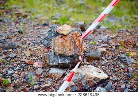 The Red Protecting Tape Is Attached On A Stone