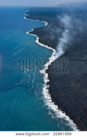 Lava flows into the ocean in Hawaii Volcanoes National Park poster
