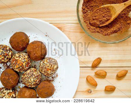 Homemade Roasted Almond Chocolate Truffles And Dark Chocolate Truffles On White Plate