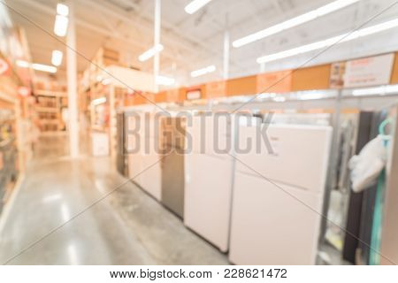 Blurred Rows Of French Door Refrigerators With Ice Makers At Retail Store