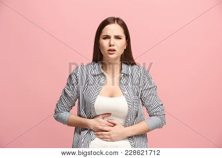 Stomach Ache Concept. The Sad Crying Woman With Stomach Ache Or Pain On Trendy Pink Studio Backgroun
