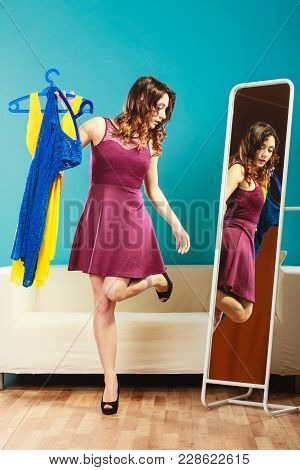 Fashion And Shopping. Woman Preparing To Party, Trying Dress Choosing Clothing. Attractive Young Wom