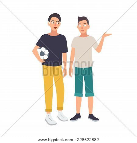 Smiling Boy With Hearing Impairment Holding Soccer Ball And Standing Together With His Friend. Deaf