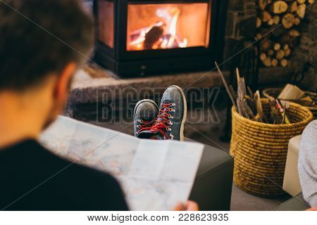 Selective Focus Moody Lifestyle Winter Photo Of Man Relaxing And Chilling In Front Of Fireplace In L