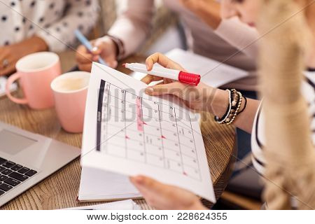 According To Plan. Young Smooth Female Hands Carrying Calendar While Planning Agenda And Marking Wit