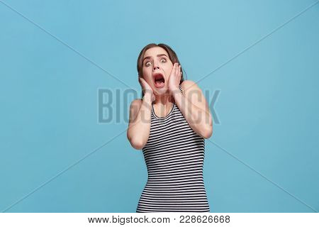 Portrait Of The Scared Woman On Blue