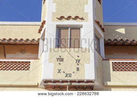 El Vendrell,spain- December 21,2017: Big Sundial Facade House In El Vendrell, Catalonia,spain.