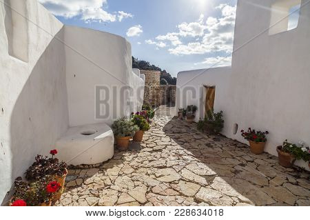 Santa Eularia Des Riu, Spain- January 12, 2018: Ancient House And Windmill Can Planetes,nowadays Is