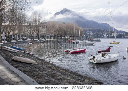 Lecco, Italy- January 10,2018: Lakeside Como, Boats, Historic Center Of Lecco, Italy.