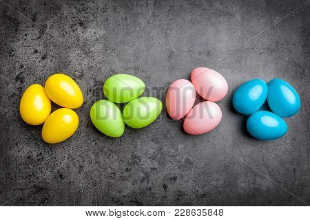 Easter Eggs On A Rustic Background
