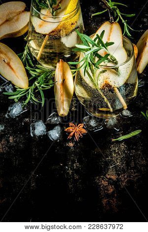 Alcohol Drink, Sweet Pear Cocktail With Rum, Liquor, Anise And Rosemary, On A Black Rusty Metallic B