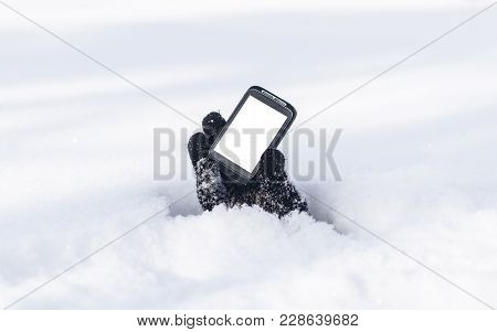 Mobile Phone With Blank Screen Copy Space In The Hand Stretching Out From Under The Snow. Contact Us