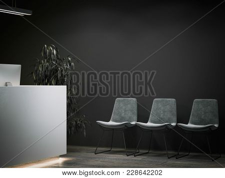 Dark Office Reception With Waiting Area And Gray Chairs. 3d Rendering