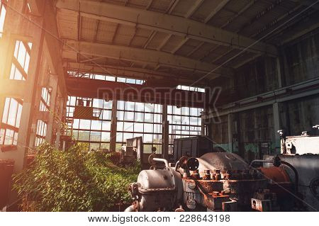 Abandoned Industrial Creepy Warehouse Inside Old Dark Grunge Factory Building With Steel Rusty Equip