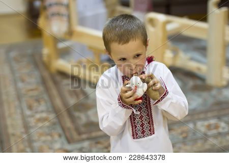 The Belarusian Boy. Belarusian Boy In National Clothes With A Toy Clay Cockerel. Children's Ethnic A