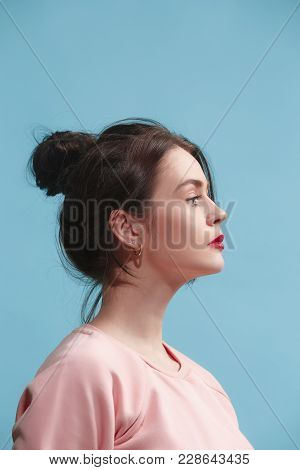 Serious, Sad Business Woman Standing Isolated On Blue Studio Background. Beautiful, Young Face. Fema