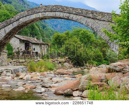 A Romanesque Bridge Made Of Donkey Back Of  Of The 17th Century, At The Entrance To The Village Of F