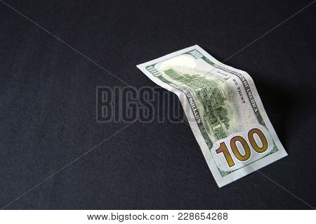 100 Usa Dollars, Many Usa Dollars Standing On Black Ground Usd 100 Dollars, Many Standing On A Black