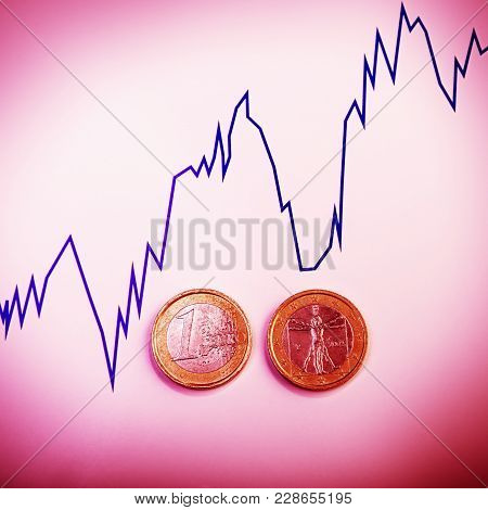 Coins One Euro Against The Currency Rate Chart. Euro Money.  Currency Of The European Union.