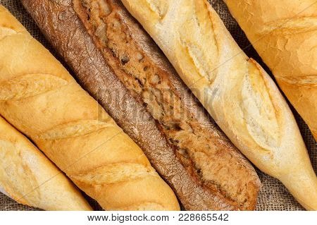 French Bread Baguettes From Bakery. Fresh Bred And Baguettes Background.