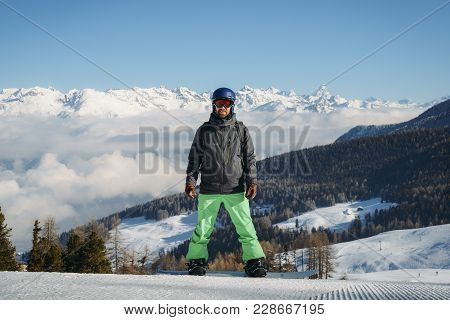 Pila, Aosta, Italy - Feb 19, 2018: Full Length Shot Of A Smiling Snowboarder Standing On The Slope I
