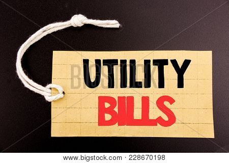 Word, Writing Utility Bills. Business Concept For Online Sale Money Bill Payment Written On Price Ta