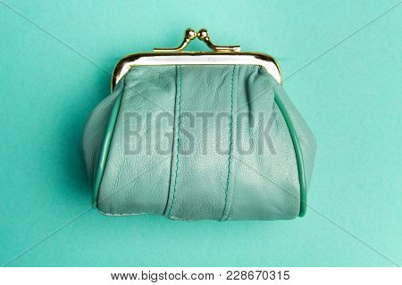 Purse For Coins.wallet For Change. A Leather Purse, Wallet On A Turquoise Background. Trend Colors.