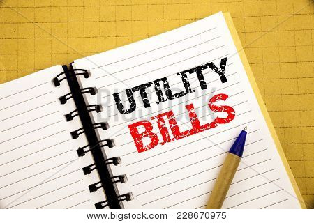 Utility Bills. Business Concept For Money Bill Payment Written On Notepad With Space On Old Wood Woo