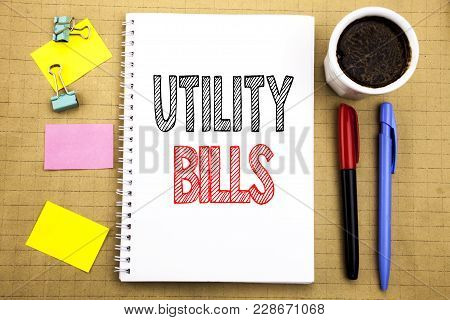 Word, Writing Utility Bills. Business Concept For Money Bill Payment Written On Notepad Paper Backgr
