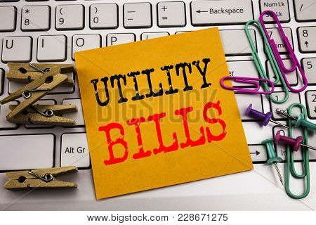 Writing Text Showing Utility Bills. Business Concept For Money Bill Payment Written On Sticky Paper