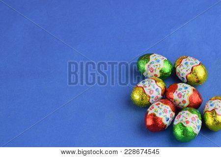 Brillant Easter Eggs On The Violet Colour Textile Cotton Background, Easter Celebrating Mood