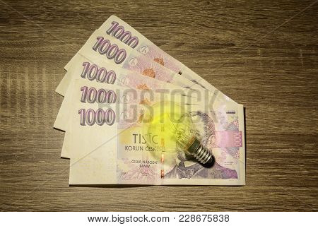European Lit Bulb Placed On Czech Money