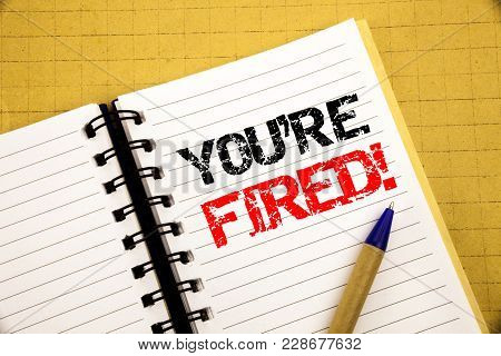 You Are Fired. Business Concept For Unemployed Or Discharge Written On Notepad With Space On Old Woo