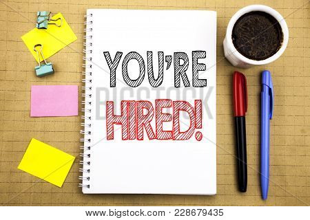 Word, Writing You Are Hired. Business Concept For Hiring Employee Worker Written On Notepad Paper Ba
