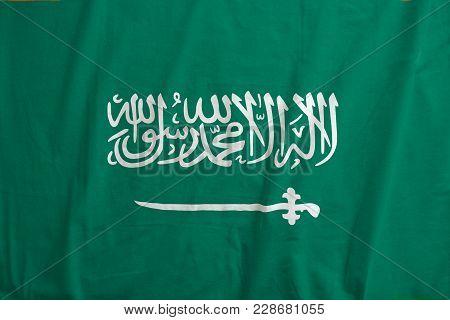 Flag Of Kingdom Of Saudi Arabia. Fabric Texture Of The Flag Of Saudi Arabia.