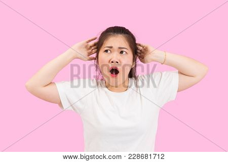 Cute Asian Woman Gets Shocked And Surprised, Hand On Her Head, Headache And Worried, Unhappy Feeling
