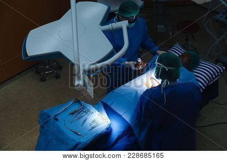 Top View Of Group Of Doctor And Assistant Surgeons Work For Rescue Patient In Operation Room At Hosp
