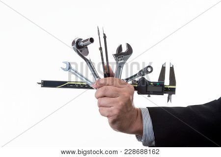 Mechanic Engineer Holding Many Kind Of Tool In His Hand; Handing Tool On White Background