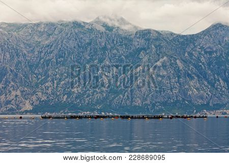 sea and mountains in bad rainy weather. Montenegro