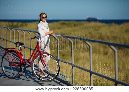 Woman relaxing with bike outdoor