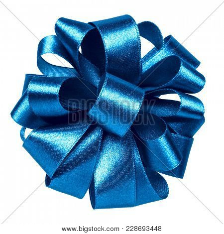 Shiny satin ribbon bow in blue color isolated on white background close up
