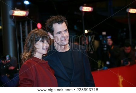 Tom Tykwer  and his girlfriend Marie Steinbach attend the closing ceremony during the 68th  Film Festival Berlin at Berlinale Palast on February 24, 2018 in Berlin, Germany.
